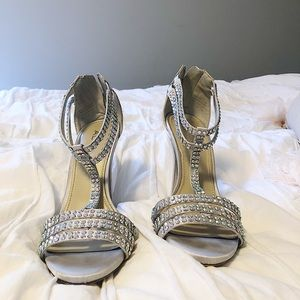 Also silver high heel shoes